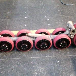 Pogumovanie kolies pásovej techniky